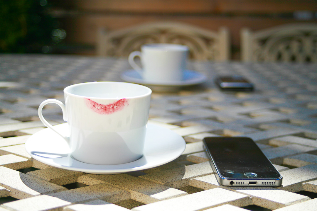 Image Of Cups And Saucers With Smartphones